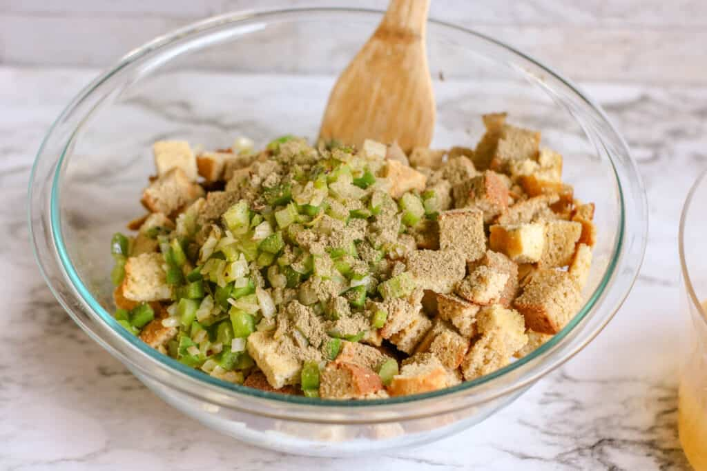 A bowl of food on a table, with Stuffing and Recipes
