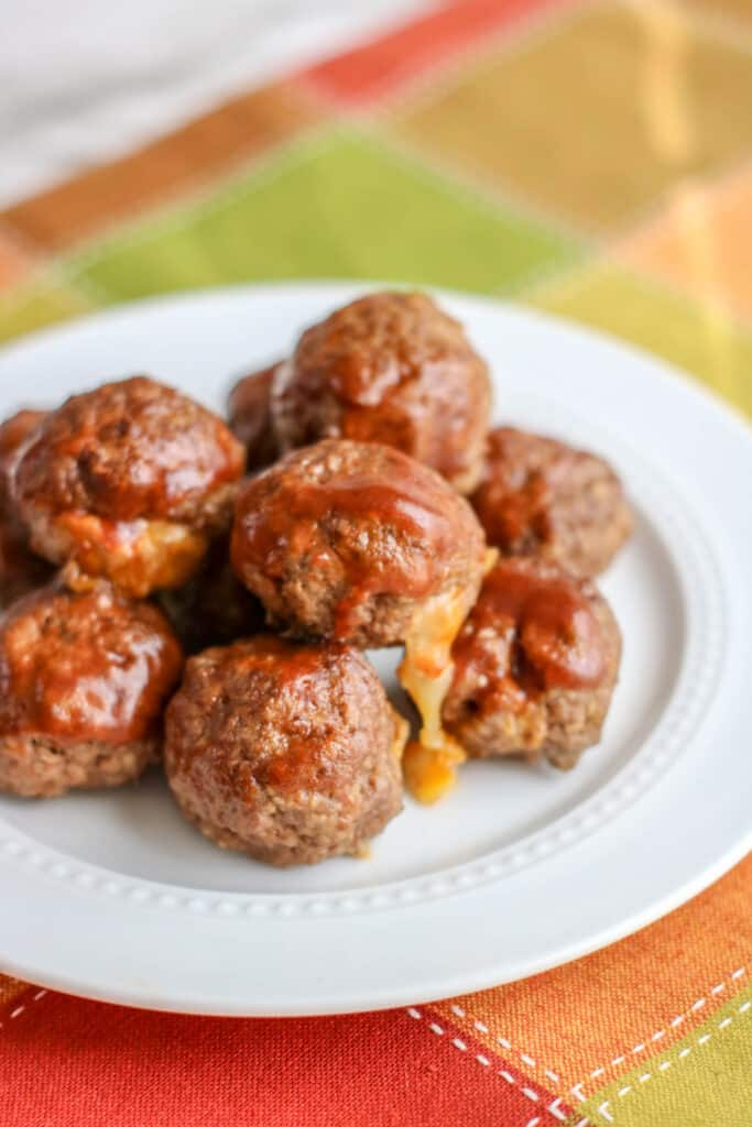 A plate of food, with Meatball and Cheese