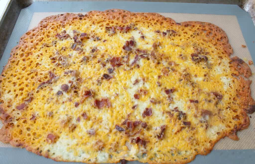 A slice of cheese and bacon
