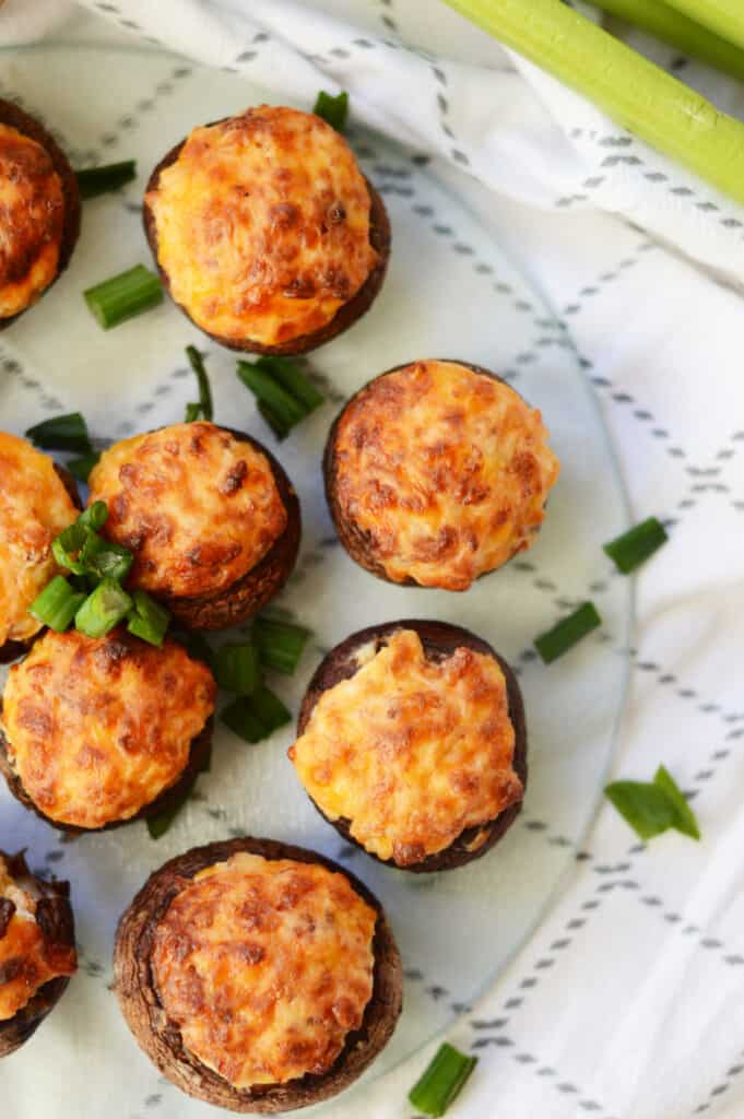 vertical image of cooked stuffed mushrooms