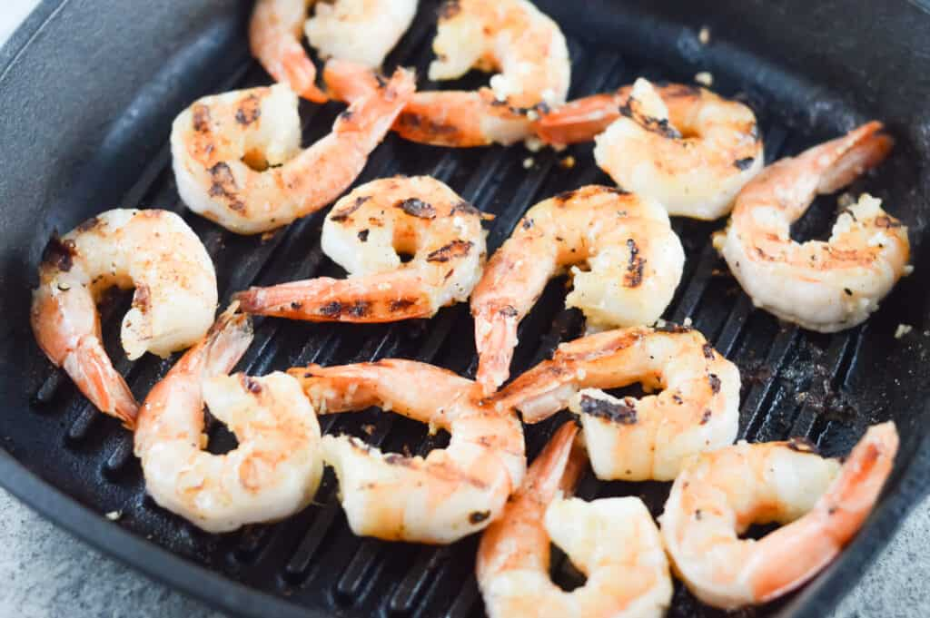 A tray of food, with Shrimp and Seasoning