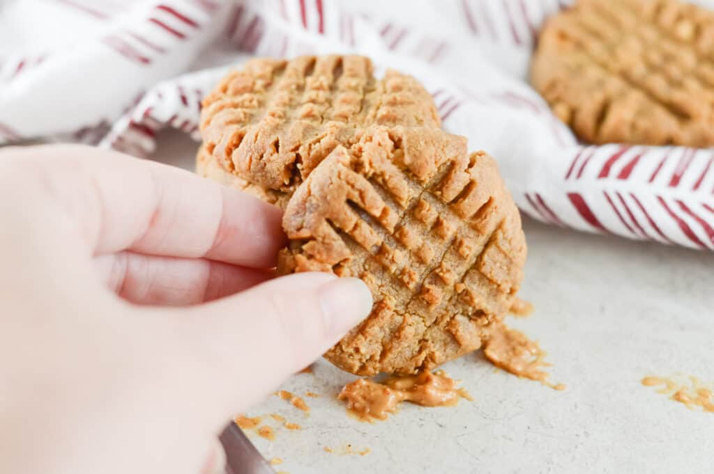Hand picking up peanut butter cookie