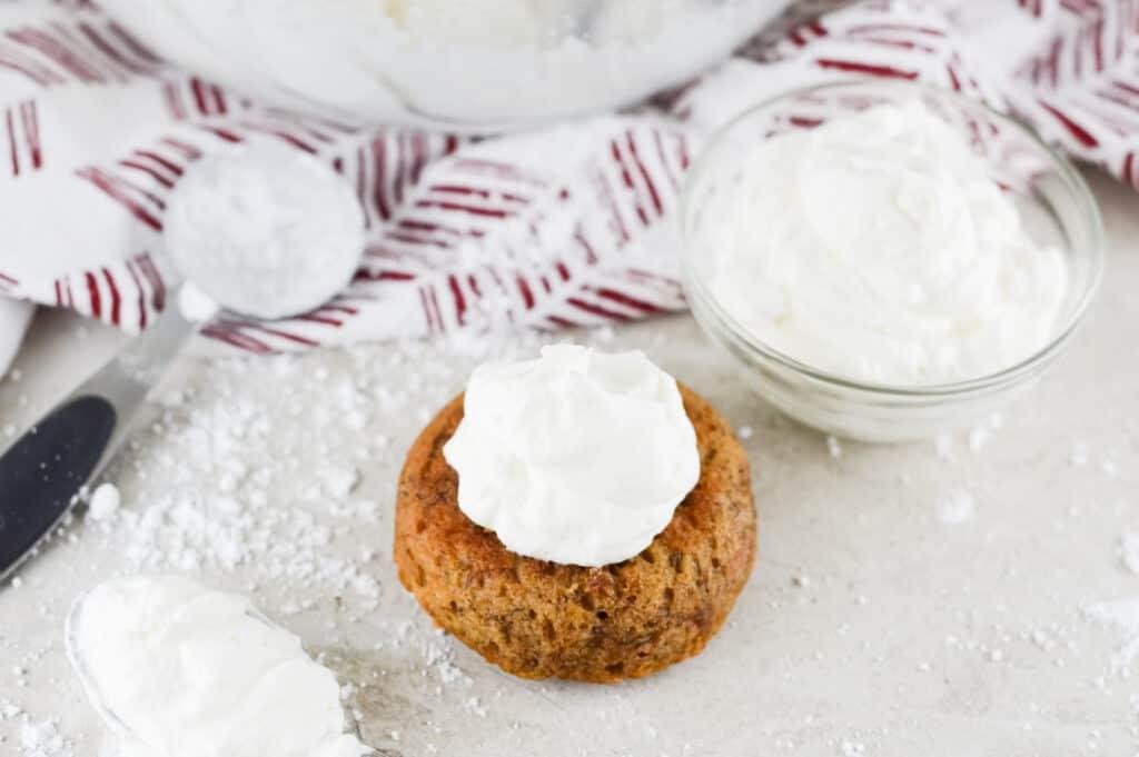 whipped cream on pumpkin muffin